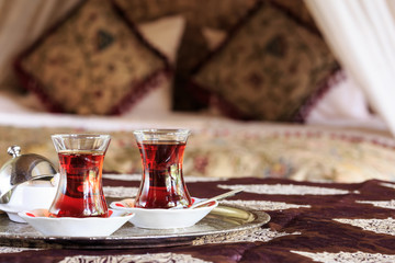 Two turkish tea cups and turkish delight with oriental canopy be