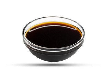 Soy sauce in glass bowl isolated on white background, with clipping path