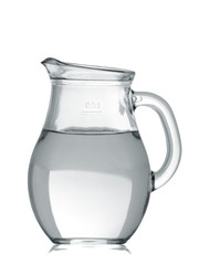 Glass jug of water isolated on white background
