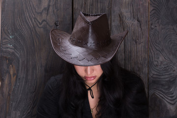portrait of a girl in a cowboy hat, a sad girl