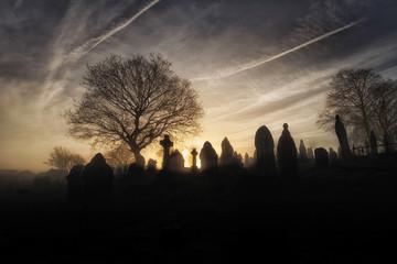 A spooky church graveyard on a misty Winter morning