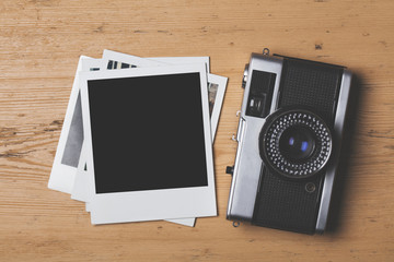 Blank vintage instant photograph with a retro camera