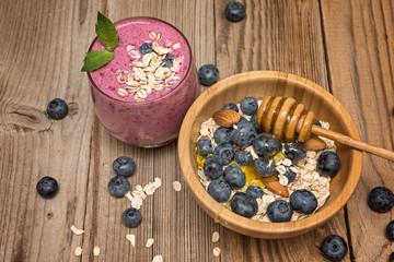 Healthy breakfast, granola and yogurt, fresh berries on rustic background.  granola and musli.
