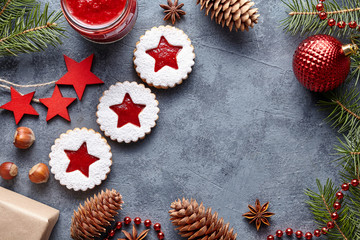 Linzer star cookies with jam filling traditional Christmas seasonal baked homemade Austrian sweet dessert food Xmas celebration pastry powdered holiday snack on vintage table background. Flat lay