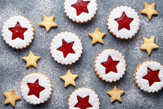 Linzer star cookies with jam filling flat lay traditional Christmas homemade Austrian sweet dessert food Xmas celebration pastry powdered holiday snack on vintage table background