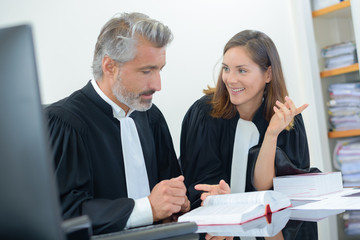 Two legal workers sat at desk