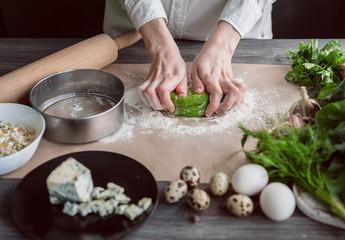 woman kneads dough for ravioli