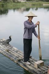 Fisherman with cormorant, Li River, Yangshuo, Guangxi Province, China, Asia