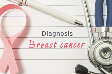 Diagnosis Breast Cancer. Pink ribbon as symbol of struggle with cancer and stethoscope lying on medical form with text labels Diagnosis Breast Cancer. Concept for branch of medicine of breast diseases
