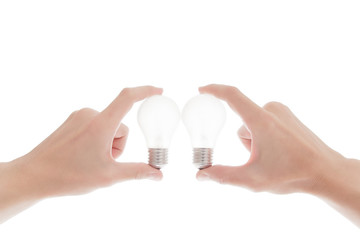 Lightbulb in a hand isolated on white background