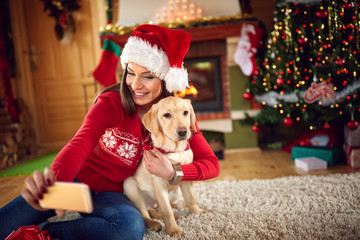 Girl taking Christmas photo with puppy