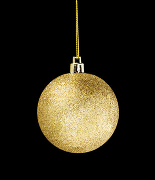 Gold glitter ball hanging isolated on dark black background obje