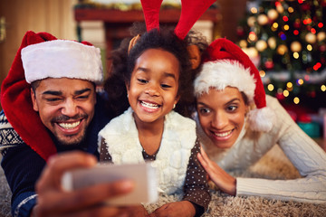 mother, father and daughter - Christmas selfie.