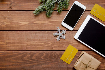 smartphone, tablet, shopping for new year online wooden table