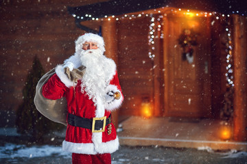Santa Claus with bell and sack of presents
