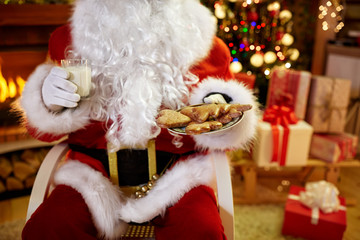 Christmas, holidays, food, drink and people concept - of Santa C