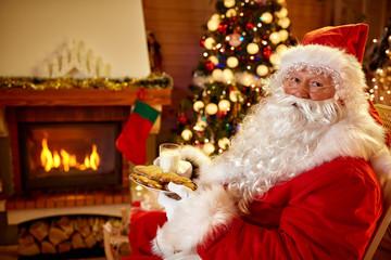 Santa Claus eats cookies and drinks  milk