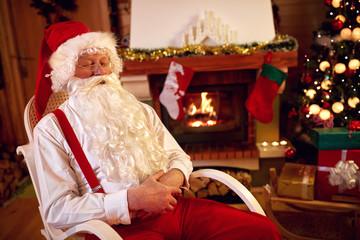 Tired Santa Claus napping