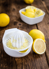 Fresh made Lemon Juice on a rustic background