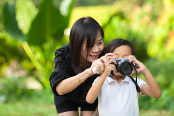 Mother and Daughter taking pictures at the nature field.
