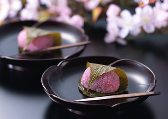 Rice cake with bean paste wrapped in a preserved cherry leaf