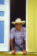 Man smoking cigar, Sosua, Dominican Republic, West Indies, Caribbean, Central America