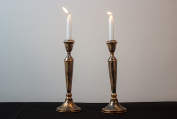 Two lit shabbat candles