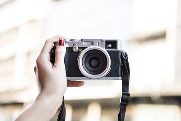 Hand Holding Carrying Camera Photograph Memory Concept