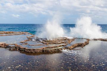 Big blowhole or sea geyser on Tongarapu island, Tonga