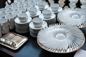 Many rows of white ceramic Spoon coffee or tea cups arrange to party or event dinner