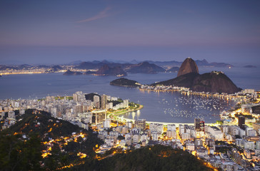 View of Sugar Loaf Mountain (Pao de Acucar) and Botafogo Bay at dusk, Rio de Janeiro, Brazil, South America