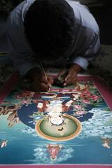 Painting a thangka depicting White Tara goddess, Buddhist symbol of long life, Bhaktapur, Nepal, Asia