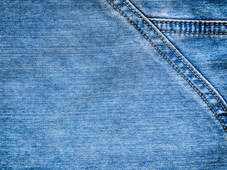 the textured background from rough cotton material or denim of p