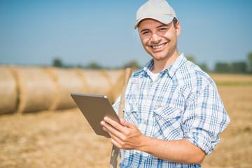 Farmer using his tablet