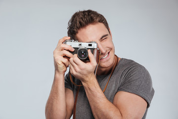 Portrait of a young man photographer with camera taking photo