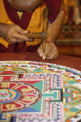 Buddhist monk drawing a mandala, Paris, Ile de France, France, Europe