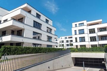 Modern white apartment houses with an underground parking seen in Berlin, Germany