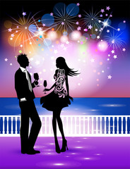 Happy new year in the sea landscape, couple in midnight party with  background of fireworks