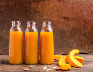 Fresh pressed juice from ripe pumpkin bottled in glass bottles o