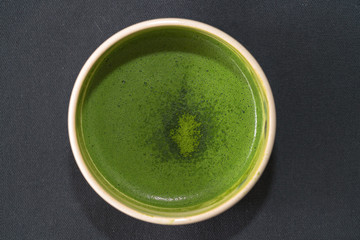 Top view of organic green matcha tea in a bow