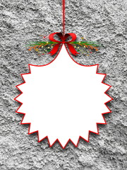Blank ornament Christmas frame hanged by red ribbon against rough concrete wall background