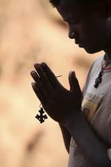 Young man praying in Lalibela, Ethiopia, Africa