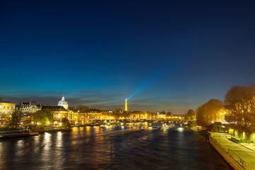 Bridge by the Seine river in Paris at night