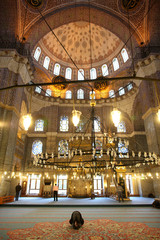 Man praying in the New Mosque, Istanbul, Turkey, Europe