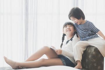 asian children reading a book
