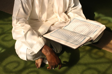 Imam reading the Koran, Brazzaville, Congo