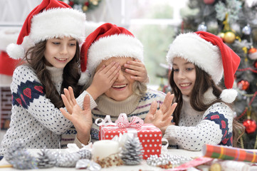 Grandmother with girls celebrating Christmas
