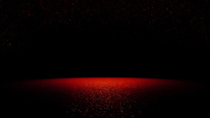 twinkling red glitter falling on a flat surface lit by a bright spotlight
