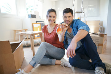 Happy couple showing keys of new home