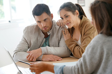 Couple meeting architect for future home designing